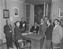 "<p>Leaders at the <a href=""/narrative/53615/en"">Wetzlar</a> displaced persons (DP) camp hold a meeting to discuss current happenings and improvements for the camp, September 9, 1948.</p>"