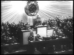 "<p>The film ""The Nazi Plan"" was shown as evidence at the International Military Tribunal in Nuremberg on December 11, 1945. It was compiled for the trial by Budd Schulberg and other US military personnel, under the supervision of Navy Commander James Donovan. The compilers used only German source material, including official newsreels. This footage titled ""Hitler Predicts Annihilation of the Jewish Race in Europe if War Occurs"" shows Hitler delivering a speech to the German parliament on January 30, 1939.</p>"