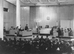 "<p>View of the courtroom during the trial of <a href=""/narrative/11530/en"">John Demjanjuk</a>. Chief defense counsel Mark J. O'Connor addresses the court during the first session of the trial. Jerusalem, Israel, February 16, 1987.</p>"