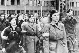 """<p>Soldiers of the Polish Home Army Women's Auxiliary Services, taken captive by the Germans in October 1944 as a result of <a href=""""/narrative/55299"""">the Warsaw Polish uprising</a>. After the uprising ended on October 2, the Germans took as prisoners of war more than 11,000 soldiers of the Polish Home Army.</p>"""