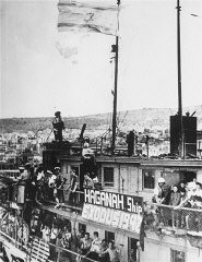 "<p>British police stand among Jewish refugees on the decks of the refugee ship <a href=""/narrative/5265""><em>Exodus 1947</em></a> at Haifa port.  British forces returned the refugees to <a href=""https://encyclopedia.ushmm.org/narrative/6365/en"">displaced persons</a> camps in Germany, dramatizing the plight of Holocaust survivors attempting to enter Palestine. July 19, 1947.</p>"
