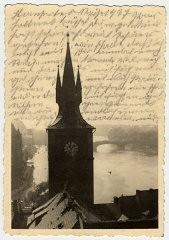 """<p>Photograph of the water tower of the Old Town Mills in Prague.</p> <p>After her deportation to the Theresienstadt ghetto in Czechoslovakia, Helene Reik yearned to record what was happening to her. This photograph was sent to Helene, who used it as paper for her diary in <a href=""""/narrative/5386/en"""">Theresienstadt</a>. Helene's makeshift diary offers wistful memories of her husband and parents who died before the war, loving thoughts of her family who had left Europe in 1939, and a firsthand account of the illness and hospitalization that ultimately led to her death.</p> <p>Because resources were scarce in the Theresienstadt ghetto, Helene recorded her thoughts, recollections, and diary entries in the margins and on the backs of family pictures that she had brought with her, as well as postcards and letters she received while in the ghetto.</p>"""