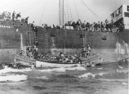 "<p>The <a href=""/narrative/7475/en"">Aliyah Bet</a> (""illegal"" immigration) ship <em>Parita</em>, carrying 850 Jewish refugees, lands on a sandbank off the Tel Aviv coast. The British arrested the passengers and interned them at Atlit detention camp. Palestine, August 21, 1939.</p>"