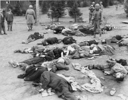 American soldiers of the Fourth Armored Division survey the dead at Ohrdruf, a subcamp of the Buchenwald concentration camp. [LCID: 76891]