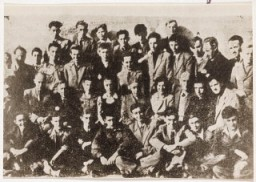 "<p>Group portrait of teenage boys in the Lodz ghetto. <a href=""/narrative/10663/en"">Dawid Sierakowiak</a> is in the 3rd row, 4th from right.</p>