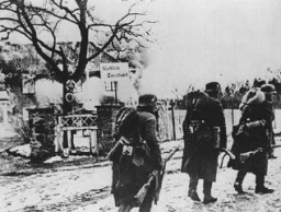<p>German troops walk past a burning hotel during the invasion of Norway. Norway, April-June 1940.</p>