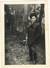 <p>Aron Derman while he was with Polish partisans in 1944. In this photograph, Aron wears a fur hat that he made and boots that he finished himself (he found them in the ghetto, unfinished, and sewed them up). Lisa Nussbaum was also a member of the partisans. Aron recounted that for a short while, Lisa was in charge of 200 women. Photograph taken in 1944, in a partisan base in the Naroch forest.</p>