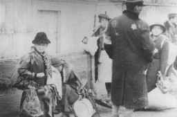 "<p>Jewish deportees from Luxembourg, Austria, and Czechoslovakia during deportation from the <a href=""/narrative/2152"">Lodz</a> ghetto to the <a href=""/narrative/3852"">Chelmno</a> killing center. Lodz, Poland, 1942.</p>"