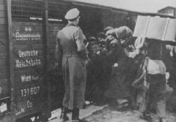 "<p>Jews are forced into boxcars for deportation to the <a href=""/narrative/3769"">Belzec</a> killing center. Lublin, Poland, 1942.</p>"