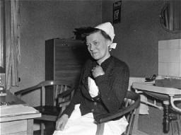 "<p>Portrait of Irmgard Huber, chief nurse at the <a href=""/narrative/8116/en"">Hadamar</a> euthanasia killing center, in her office. The photograph was taken by an American military photographer on April 7, 1945.</p>"