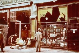 "<p>Storefronts of Jewish-owned businesses damaged during the <a href=""/narrative/4063/en""><em>Kristallnacht</em></a> (""Night of Broken Glass"") pogrom. Berlin, Germany, November 10, 1938.</p>"