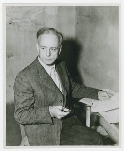 "<p>Foreign Minister of Germany from 1938 to 1945, <a href=""/narrative/9878/en"">Joachim von Ribbentrop</a> sits in his cell during <a href=""/narrative/9366/en"">the Nuremberg trials</a>. Photographed circa November 20, 1945 – October 01, 1946.</p>"