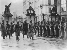"<p>Adolf Hitler reviews his troops at Prague castle on the day of the occupation. Prague, <a href=""/narrative/7295/en"">Czechoslovakia</a>, March 15, 1939.</p>"
