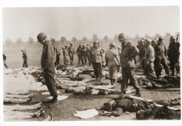 American soldiers view the bodies of prisoners laid out in rows in an open field at Ohrdruf, a subcamp of Buchenwald in Germany. [LCID: 38099]