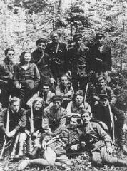 "<p>Group portrait of a Jewish <a href=""/narrative/5679/en"">partisan</a> unit operating in the Lithuanian forests. Many of its members had been involved in resistance activities in the <a href=""/narrative/3182/en"">Kovno</a> ghetto. Lithuania, 1944.</p>"