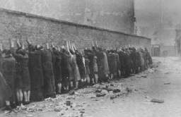 "<p>Jews captured during the <a href=""/narrative/3636/en"">Warsaw ghetto uprising</a>. Poland, April 19–May 16, 1943.</p>"