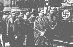 "<p>Adolf Hitler and other participants in the Hitler Putsch, during the annual anniversary celebration of his failed attempt to seize power. Behind Hitler stand Rudolf Hess (left) and <a href=""/narrative/10813"">Heinrich Himmler</a>. Munich, Germany, November 9, 1934.</p>"