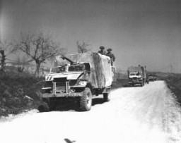 """<p>Soldiers and vehicles of the <a href=""""/narrative/4750/en"""">Jewish Brigade Group</a>, which participated in the final Allied offensive in Italy. Italy, March 24, 1945.</p>"""