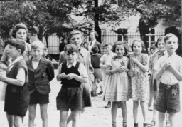 "<p>A photograph of Jewish children in the <a href=""/narrative/5386"">Theresienstadt</a> ghetto taken during an inspection by the International Red Cross. Prior to this visit, the ghetto was ""beautified"" in order to deceive the visitors. Czechoslovakia, June 23, 1944.</p>"