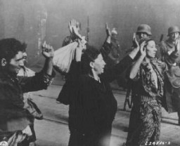 "<p>Members of the Jewish resistance are captured by SS troops on Nowolipie Street during the suppression of the <a href=""/narrative/3636/en"">Warsaw ghetto uprising</a>. Warsaw, Poland, April 19-May 16, 1943.</p>"