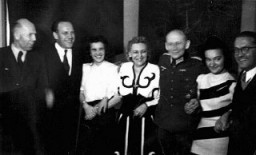 """<p>Scene from one of <a href=""""/narrative/7526/en"""">Oskar Schindler</a>'s parties in Krakow. At such events, Schindler (second from left) attempted to bribe Nazi officials for information about imminent deportations. Krakow, Poland, 1943.</p>"""