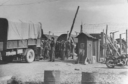 "<p>The last group of European Jewish refugees leaves a British <a href=""/narrative/26091/en"">detention camp</a> for Israel. Cyprus, February 10, 1949.</p>"