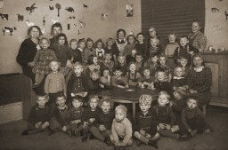 <p>Portrait of a preschool class in Copenhagen. Gus Goldenburger (top row, second from left) was one of the few Jewish students in the class. His family moved to Denmark from Czechoslovakia, fearing the rising tide of Nazism. When the Nazis planned to deport Danish Jewry, the Goldenburgers managed to escape to Sweden, where they remained until the end of the war. After the war, the Goldenburgers returned to Copenhagen. Photograph taken in Copenhagen, Denmark, 1938–1939.</p>