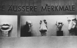"<p>At <em>Der ewige Jude</em> (The Eternal Jew), a Nazi anti-Jewish <a href=""/narrative/81/en"">propaganda</a> exhibition, a case features ""typical Jewish external features."" Munich, Germany, November 1937.</p>"