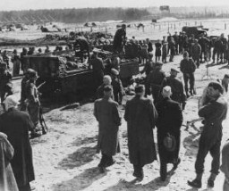"<p>After <a href=""/narrative/8176/en"">liberation</a> of the <a href=""/narrative/4549/en"">Bergen-Belsen</a> camp, British soldiers forced German mayors from nearby towns to view mass graves. Bergen-Belsen, Germany, after April 15, 1945.</p>"