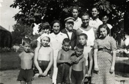 Janusz Korczak poses with children and staff in his orphanage