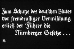 """33º Slide de uma Propaganda Nazista Entitulada """"A Alemanha Domina os Judeus."""""""