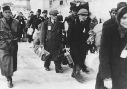 <p>Deportation of Slovak Jews. The victims wear tags and are escorted by Slovak guards. Czechoslovakia, ca. 1942.</p>