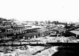 """<p>View of the industrial section of the <a href=""""/narrative/4880/en"""">Plaszo</a>w camp. Plaszow, Poland, 1944.</p>"""