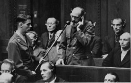 """<p>On September 15, 1947, defendant Paul Blobel pleads not guilty during his arraignment at the <a href=""""/narrative/9545/en"""">Einsatzgruppen Trial</a>. Blobel was the commander of the unit responsible for the massacre at<a href=""""/narrative/5337/en"""">Babi Yar</a> (near Kiev). He was convicted by the military tribunal at Nuremberg and sentenced to death. Blobel was hanged at the Landsberg prison on June 8, 1951.</p>"""