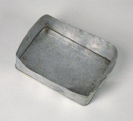 Aluminum food container lid used by a Hungarian Jewish family on the Kasztner train.