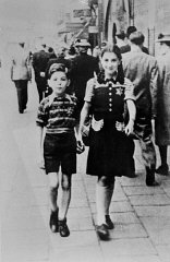 Jewish children wearing the compulsory yellow badge.