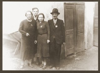 Portrait of the Weidenfeld family wearing Jewish badges in the Czernowitz ghetto