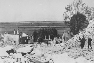 SS officers stand among the rubble of Lidice during the demolition of the town's ruins in reprisal for the assasination of Reinhard ...