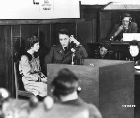 Fifteen-year-old Maria Dolezalova testifies for the prosecution at the RuSHA Trial.