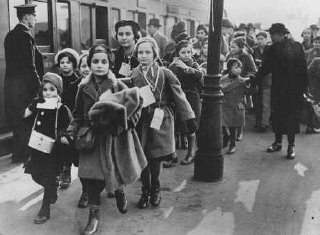 Austrian Jewish refugee children, members of one of the Children's Transports (Kindertransporte), arrive at a London train station.