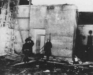 Soviet soldiers guard the entrance to Hitler's underground bunker.