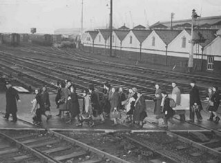 Jewish refugee children, part of a Children's Transport (Kindertransport) from Germany, soon after arriving in Harwich.