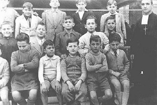 Portrait of a boarding school class in which a Jewish boy was hidden.