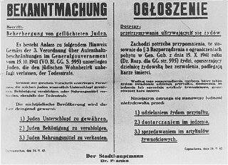 A Nazi decree issued in October 1941, in German and Polish, warns that Jews leaving the ghetto, or Poles who aid them, will be executed.
