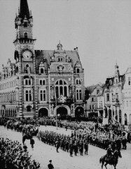 In the aftermath of the Munich agreement, which turned the Sudetenland of Czechoslovakia over to Germany, German troops march into ...