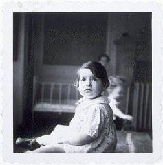 A young girl in a home for Jewish infants waiting for their families to claim them or be adopted.