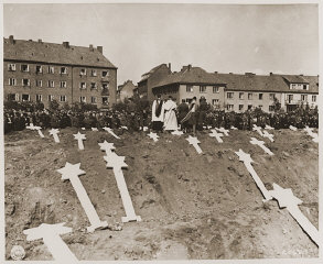 Under orders from officers of the US 8th Infantry division, German civilians from Schwerin attend funeral services for 80 prisoners ...