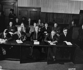 The I. G. Farben defendants hear the indictments against them before the start of the trial.