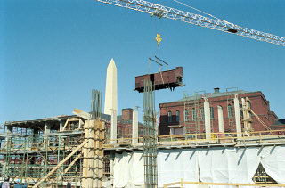 Installation of the railcar at the construction site of the United States Holocaust Memorial Museum.