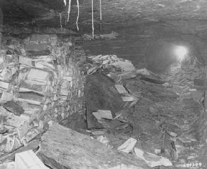 Einsatzstab Rosenberg looted  materials of Jewish culture like these books found stacked in the cellar of the Nazi Institute for ...